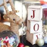 Christmas Display with Reindeer, Letter Blocks, Cloche Dome and Snow Globe.