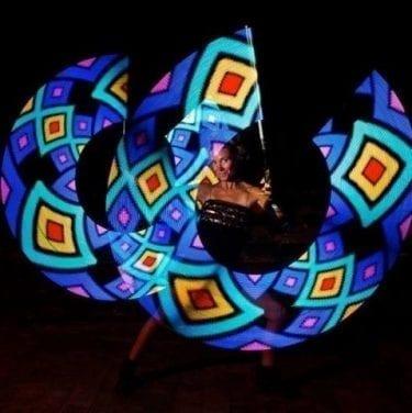 poi artist creating luminescent geometric pattern