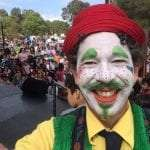 Spablo the Clown taking a Selfie on a stage.