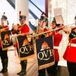 Marching band with trumpets with QVB banners in Sydney.