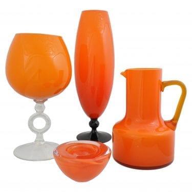 Funk Orange Glassware Range with Orange glass jugs, cups, and bowls